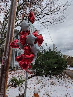 balloon display set up on the corner of Elwood St