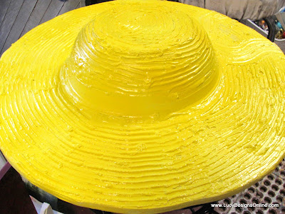 yellow straw hat sculpture