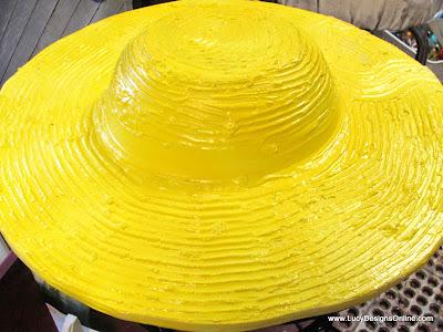 yellow straw hat sculpture