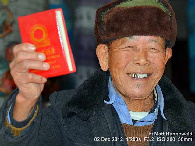 close up, people, Chinese people, Chinese man, portrait, street portrait, headshot, South China, Yunnan province, Kunming, Mao's little red book