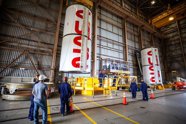 The NASA worm is painted on the side of two segments that will fly on the twin solid rocket boosters of the Space Launch System (SLS) during Artemis 1 next year.