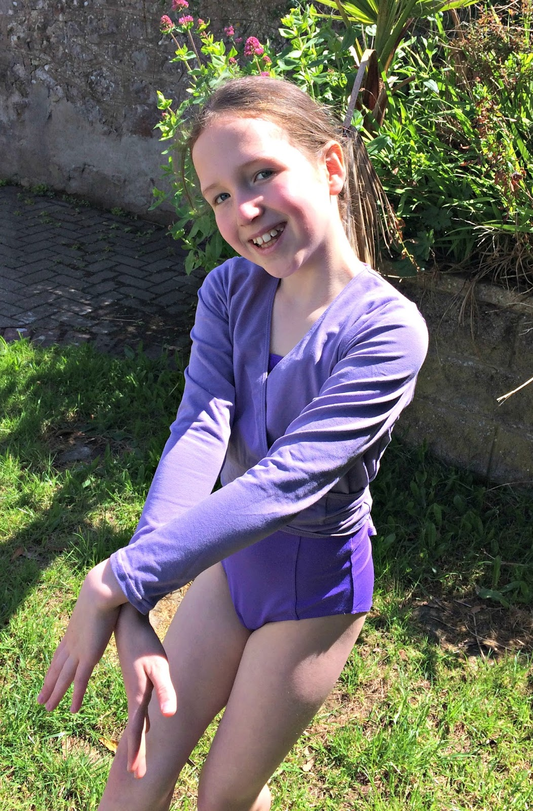 Caitlin practising ballet in the garden