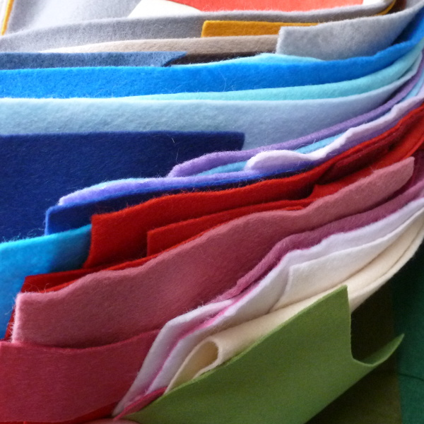 Assorted felt fabric sheets with different colors mix red blue pink green gray purple
