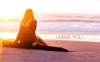 girl sitting in front of sea beach with i miss you text pic