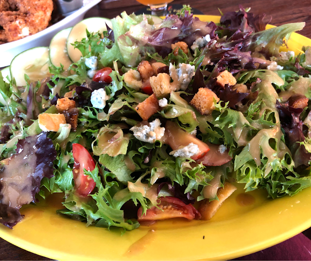 Vibrant and fresh mixed green salad at Ten Ninety Brewing.
