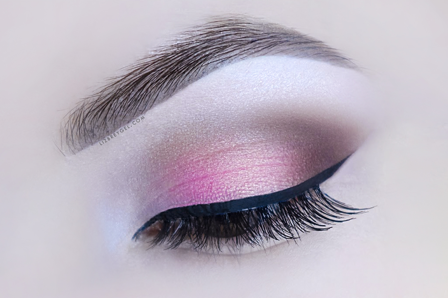 a close up picture of a closed eye with soft, romantic makeup look for Valentines Day