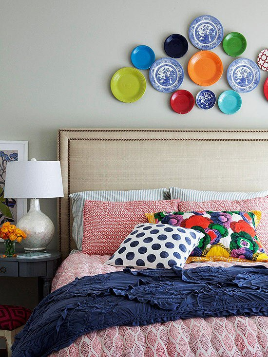 A Lovely Display of Plates Behind the Bed add the Perfect Pop