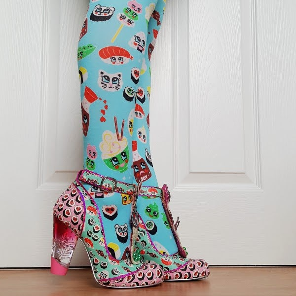 wearing bright tights with sushi theme and shoes