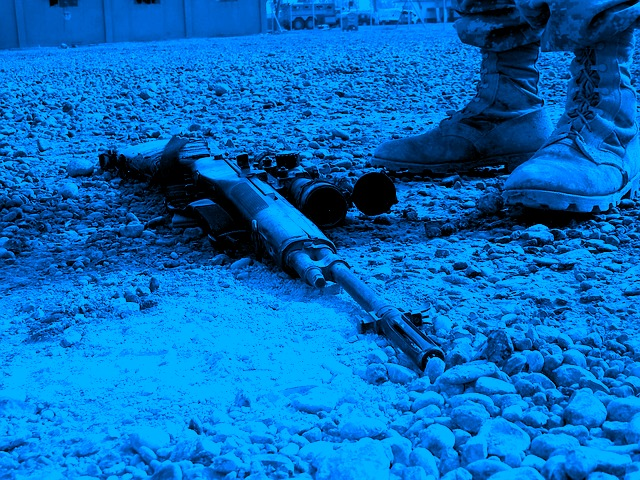 Discarded Sniper Rifle At The Feet of A Sniper