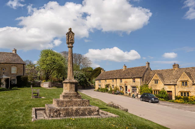 Village green and old houses in Guiting Power deep in the Cotswolds