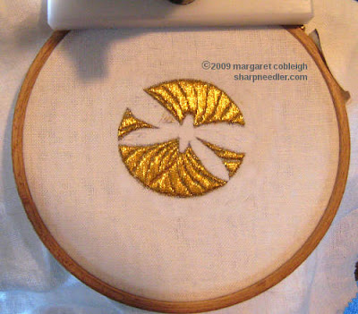 Underside couching with gold thread completed with swirl pattern clearly visible
