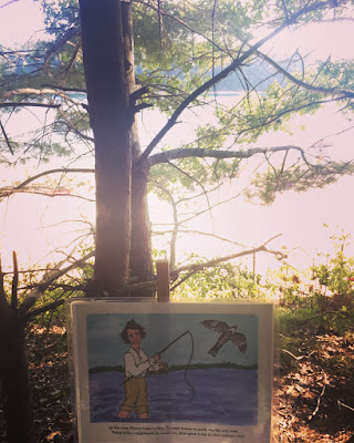 illustrated art walk of Walden Pond featuring drawing of Henry David Thoreau fishing