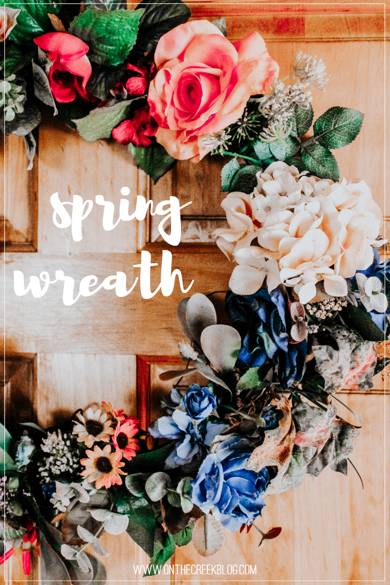 Handmade spring/summer wreath using random yard sale flowers!