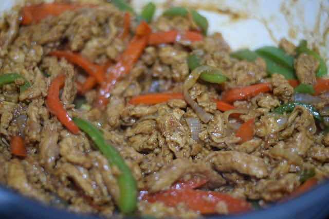the soy curl pepper steak cooking in the pan.