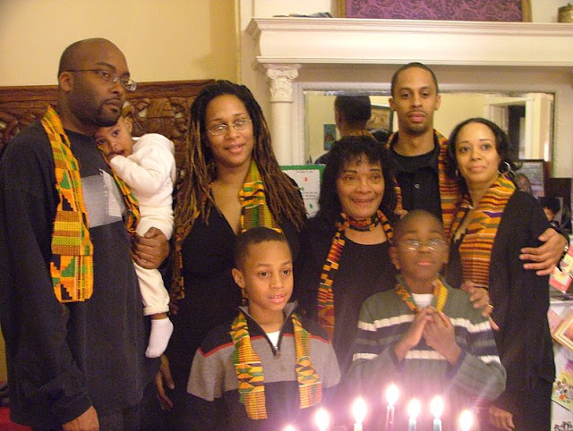 Image: The family celeberates Kwanzaa | From Wikimedia Commons, the free media repository