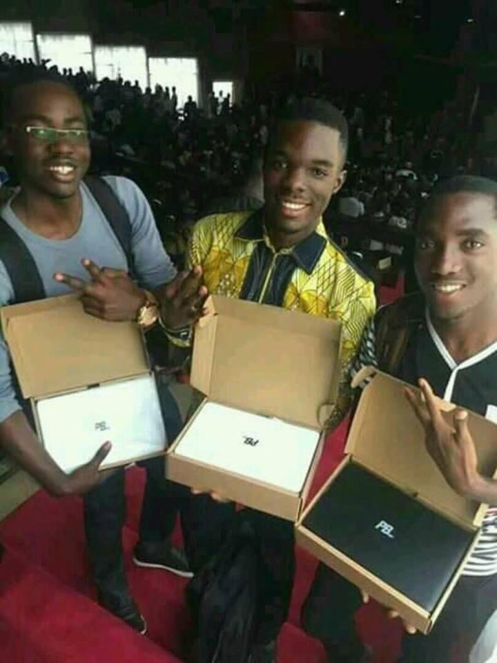 University students receiving PBHEV Laptops