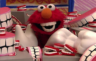 When Elmo opens the door of the room, a lot of chattering teeth fall on him. Sesame Street Elmo's World Teeth