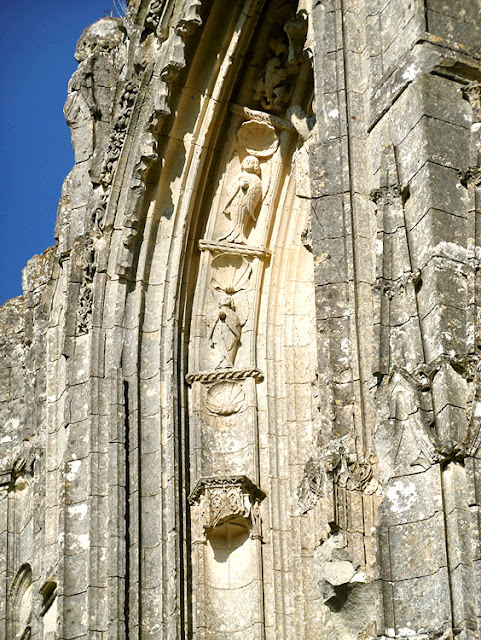 Seraphims on the entrance to the ruined church at Les Roches Tranchelions, Indre et Loire, France. Photo by Loire Valley Time Travel.