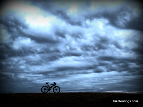 Picture of mountain bike on hill top cloud scenic