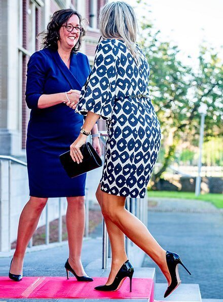 Queen Maxima's outfit is by Belgian fashion house Natan. Come out of your debt congress
