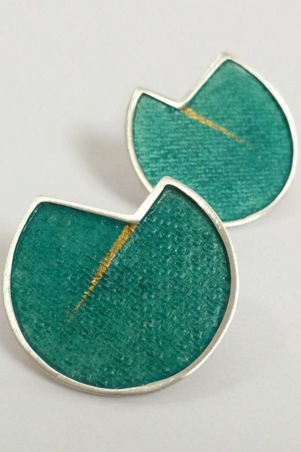 circular silver, aqua, and gold painted paper earrings