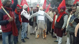 cpi-ml-burn-modi-statue-madhubani