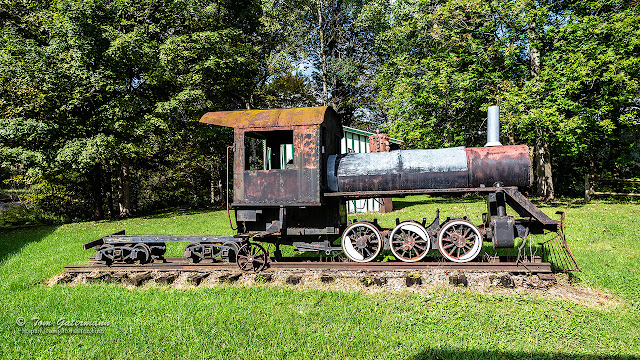 A rusting steam locomotive display at the Martisco Station