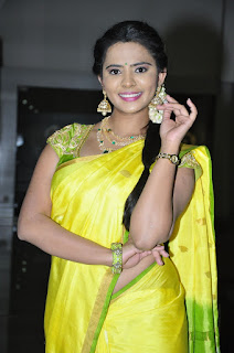 Actress Manasa Stills in Yellow Saree at Savitri Audio Launch 0024