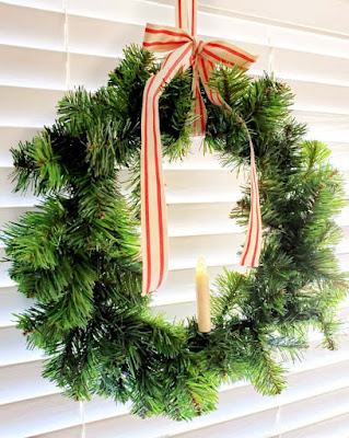 window wreath with striped ribbon and clip on light