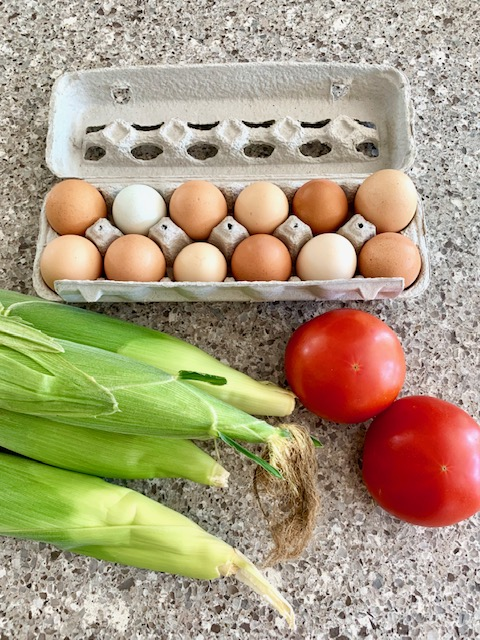 Eggs, corn and tomatoes at new town farmer's market