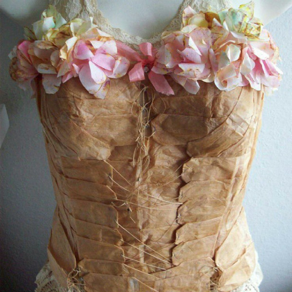 Vintage yellowed paper laced bodice with paper flowers across neckline
