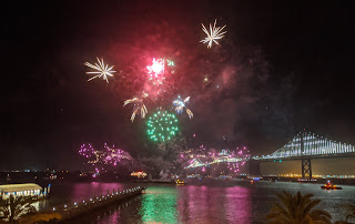 Fireworks over San Francisco bay with the Bay Bridge in the foreground