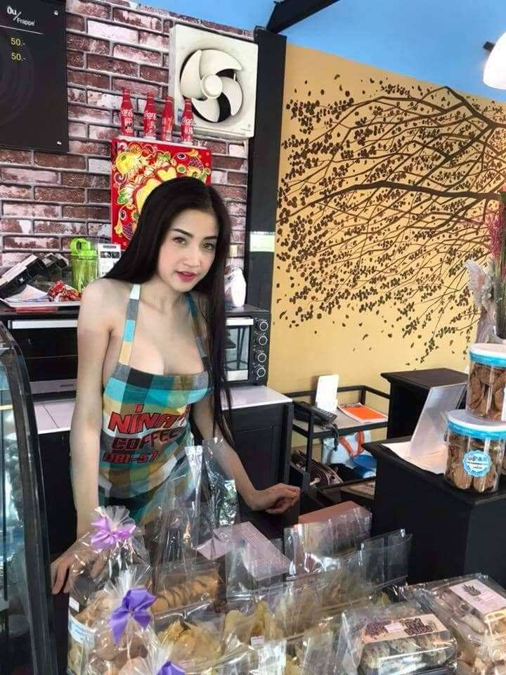 The Coffee-shop owner in Thailand may face charges over saucy waitress post.