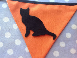 black cat placed onto bunting