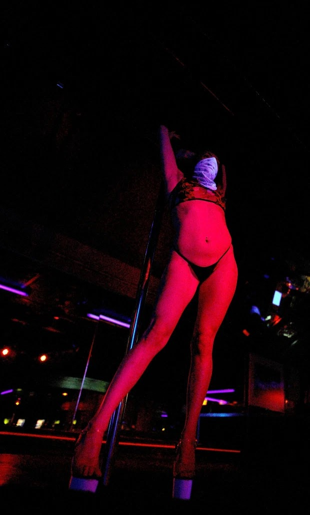 'Masks on, clothes off' America's Strip club reopens after coronavirus lockdown