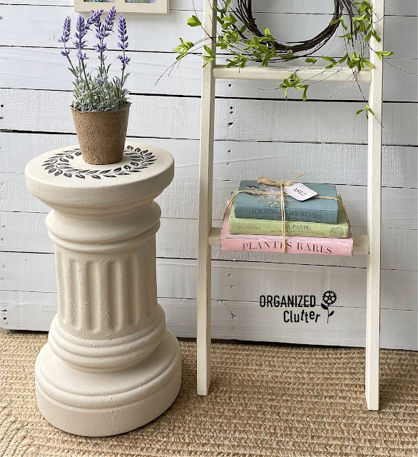 Photo of terracotta off white pedestal staged with potted lavender and a ladder
