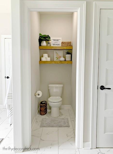floating wood shelves over toilet