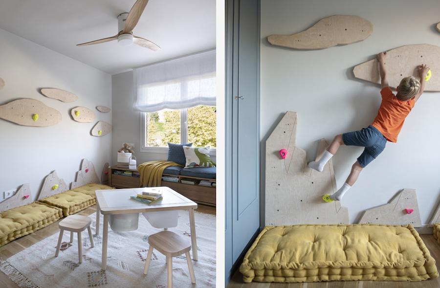 Dormitorio infantil con zona de escalada y ventilador en el techo