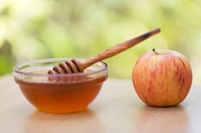 Eating apples dipped in honey is a tradition during Rosh Hashanah.