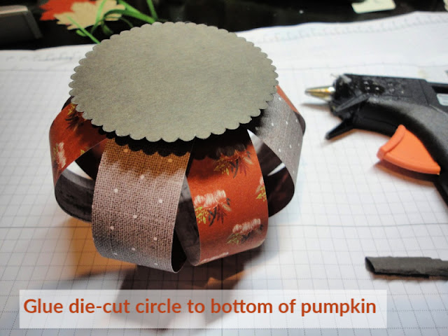 Glue die-cut scalloped circle to bottom of pumpkin - Nicole Steele The Joyful Stamper
