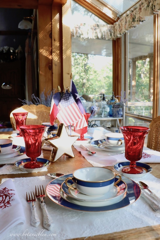 Labor Day patriotic French Country table setting with blue and white plates and soup bowls