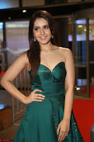 Raashi Khanna in Dark Green Sleeveless Strapless Deep neck Gown at 64th Jio Filmfare Awards South ~  Exclusive 120.JPG