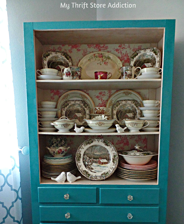 How to Transform Shelves with Thrift Store Paper mythriftstoreaddiction.blogspot.com China cabinet makeover using thrift store draw liners and removing cabinet doors.