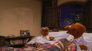Cousin Bear is staying at Baby Bear's house. Cousin Bear sees a tree's shadow on the wall and he fears that it is the Boogey Bear. Sesame Street Bedtime with Elmo