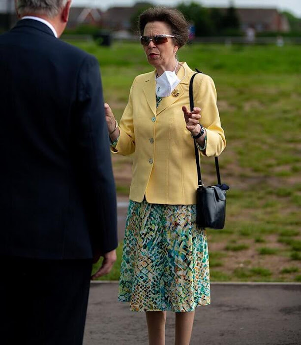 The Princess Royal wore a yellow jacket, blazer and floral print midi skirt or dress. Burgundy leather bag and sunglasses