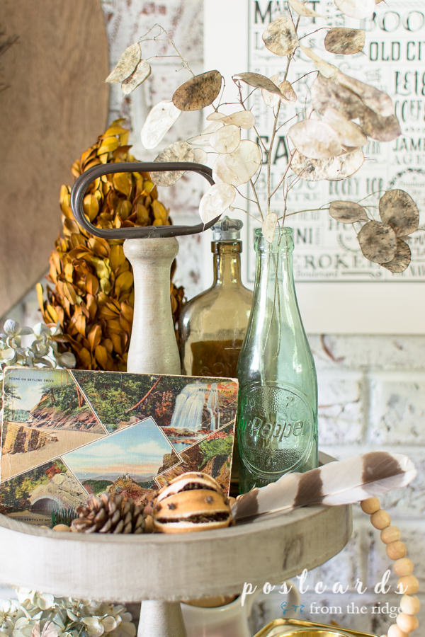 vintage and natural items as fall decor on wooden tiered tray