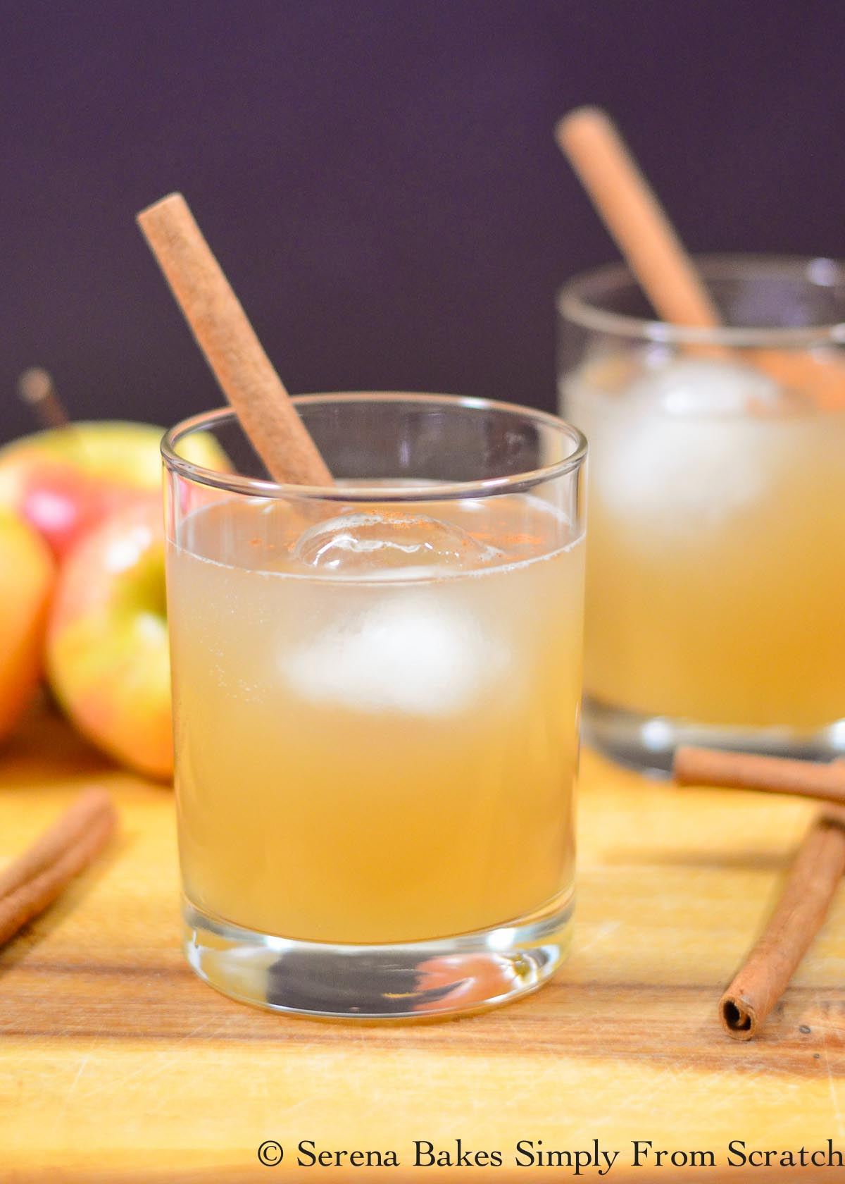 Apple Cider and Whisky with Ginger Beer garnished with a cinnamon stick.