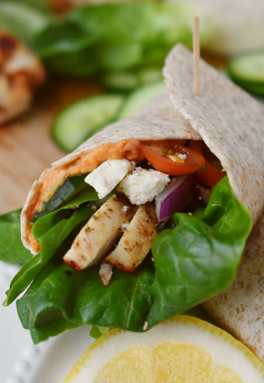 Wrap with chicken, feta cheese, tomatoes, cucumbers