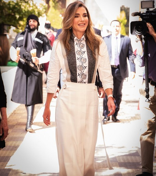 Queen Rania wore Chloe hoop trim contrast panel blouse, Proenza Schouler crepe midi skirt and Dior D-Choc pumps