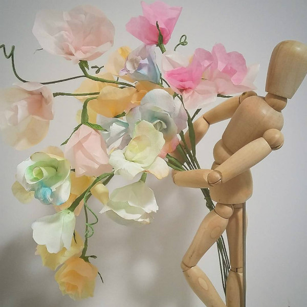 Wooden 3D Stick Figure Holding Paper Sweet Pea Bouquet